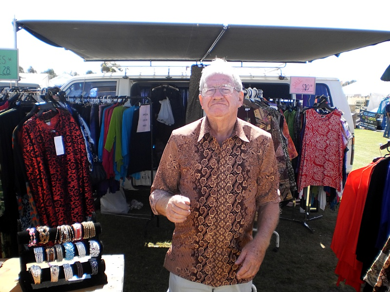 Bill at a market proudly showing off some of his stock.